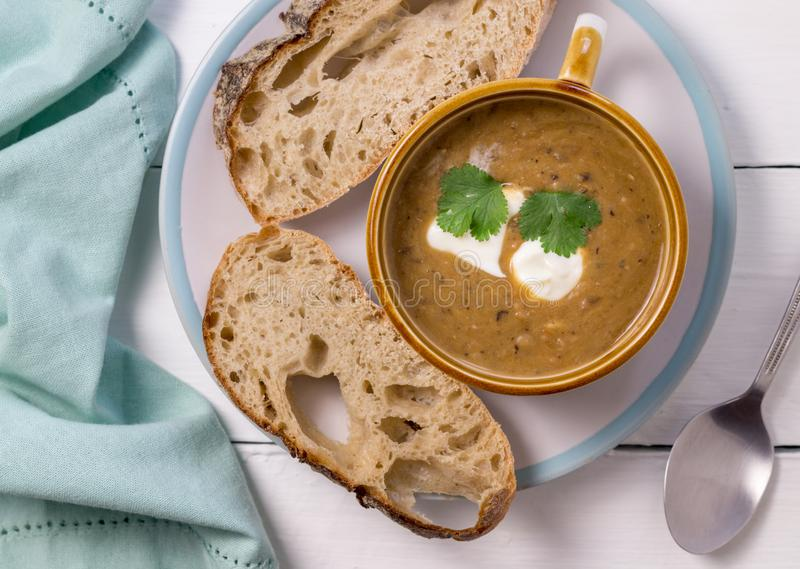 Vegetable soup with bread slices - Top view photo on white table stock photo