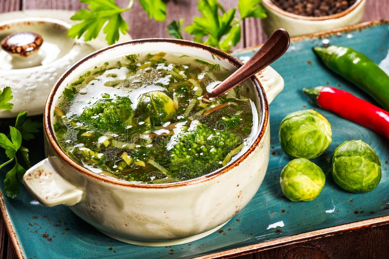 Vegetable soup of broccoli, brussels sprouts and onions on dark wooden background, healthy food. Vegetarian food. Diet food. Top view stock photography