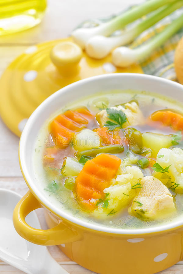 Vegetable soup. With fresh buns royalty free stock photo