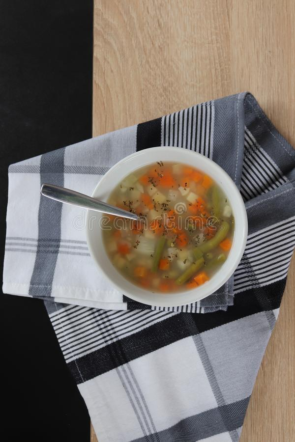 Vegetable soup with groats and oregano stock images
