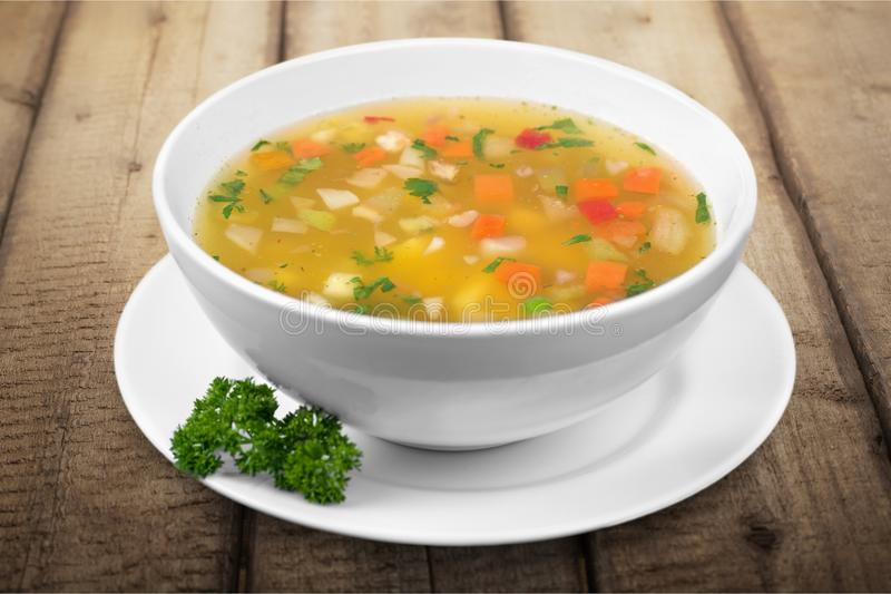 Vegetable soup isolated on a white background stock photo