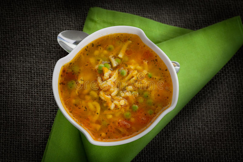 Vegetable soup. Stew with carrots, peas, pasta and parsley stock photos