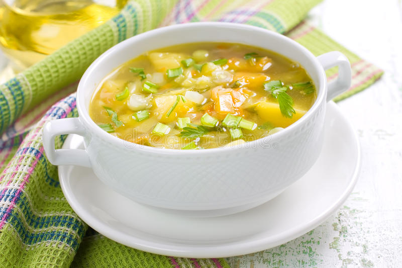 Vegetable soup. In a white bowl stock images