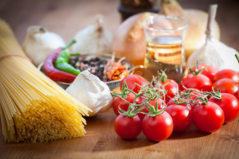 Vegetable and spaghetti pasta. Spaghetti pasta with olive oil and basil, garlic and tomato royalty free stock images