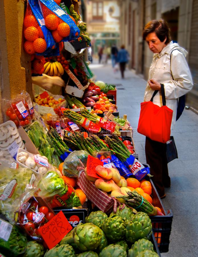 Vegetable Stand Market Old Woman Shopping royalty free stock photo