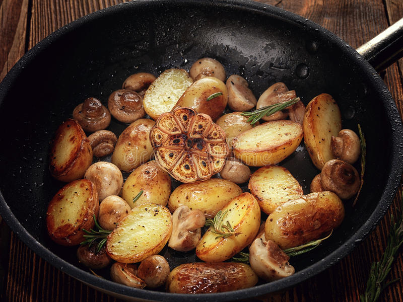 Vegetable stew of potatoes and mushrooms. stock photo