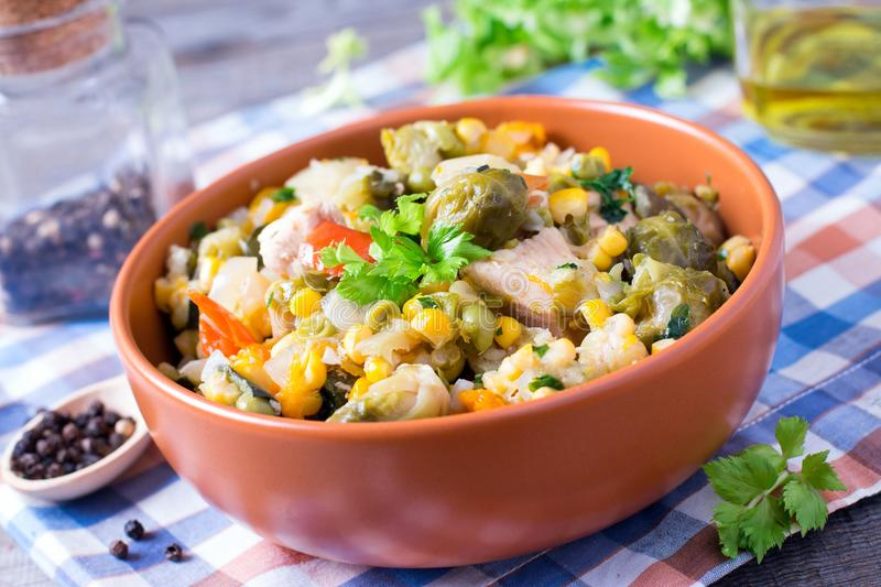 Vegetable stew. Stewed vegetables in in a plate on an old wooden table. royalty free stock photo
