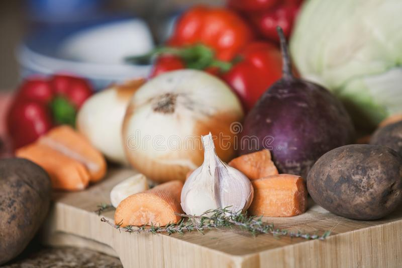 Vegetable still life. garlic, potatoes, onion on board royalty free stock image