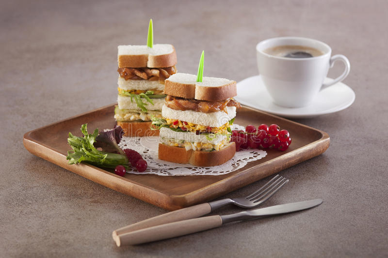 Vegetable toast on wooden tray with coffee and lettuce royalty free stock photos