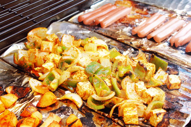 Vegetable tofu and hot dog grilling on grill. Marinade fresh vegetable tofu and hot dog grilling on grill stock photos