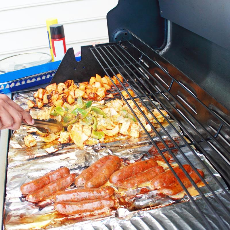 Vegetable tofu and hot dog grilling on grill. Marinade fresh vegetable tofu and hot dog grilling on grill royalty free stock photo
