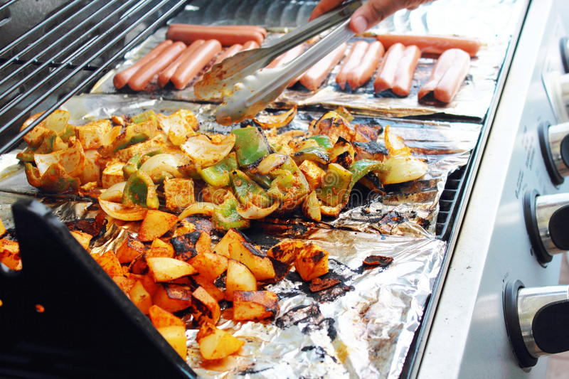 Vegetable tofu and hot dog grilling on grill. Marinade fresh vegetable tofu and hot dog grilling on grill royalty free stock photography