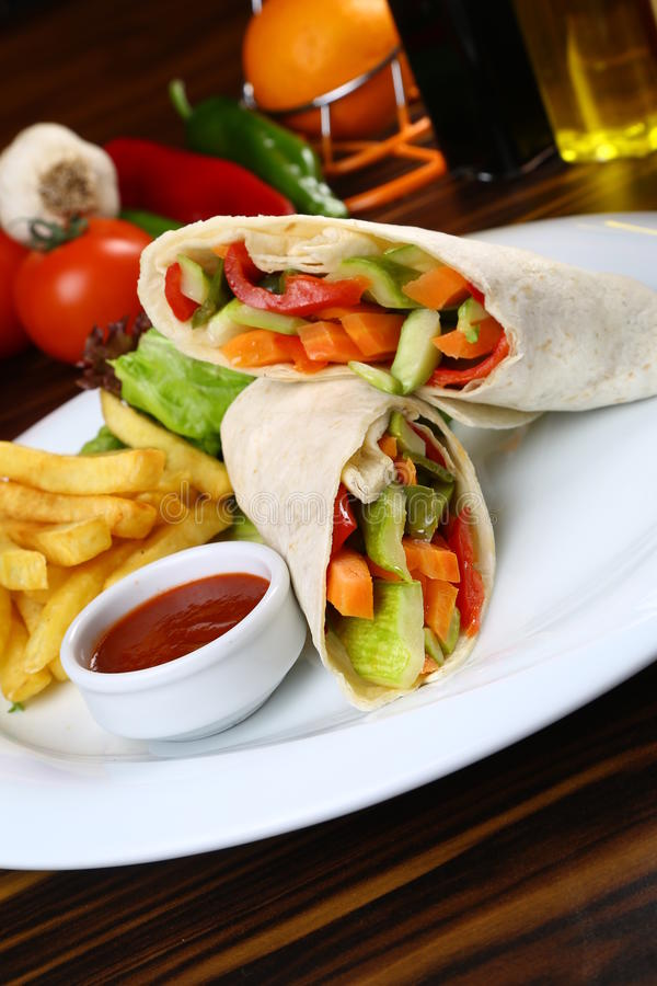 Vegetable Wrap with French Fries. Vegetables wrapped in pita bread with French Fries stock photos
