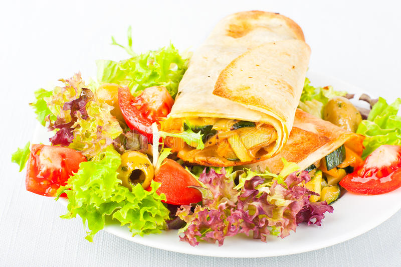 Vegetable wraps. Roasted vegetalbe wraps served with salad stock images