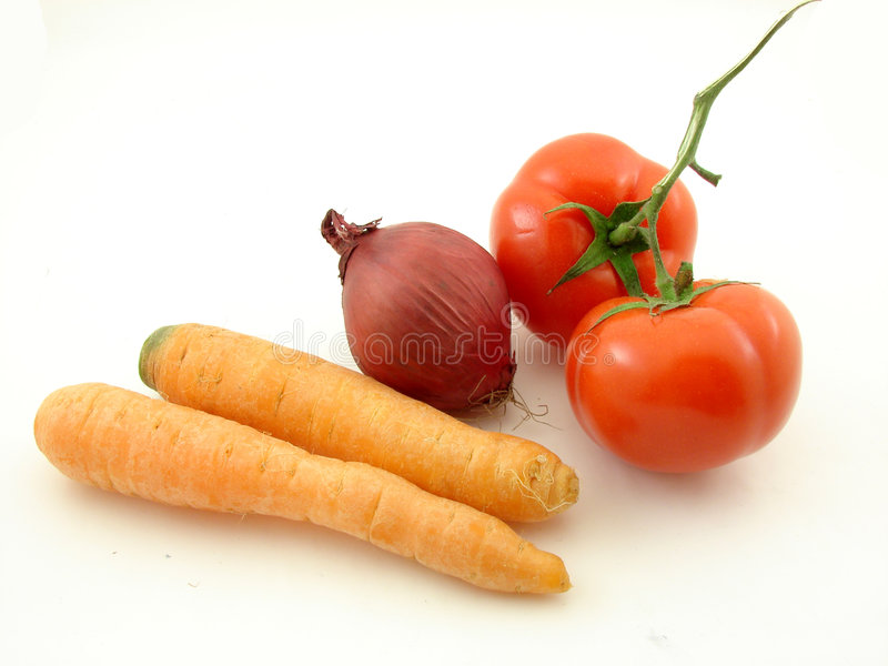Vegetables. Tomatoes, carrots, and red onion isolated on the white background stock photography