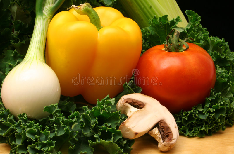 Vegetables. Onion, Pepper and Tomato royalty free stock photography