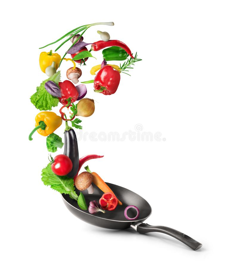 Free Vegetables Are Flying Out Of The Pan Isolated On White Background. Healthy Food Stock Photography - 158040082