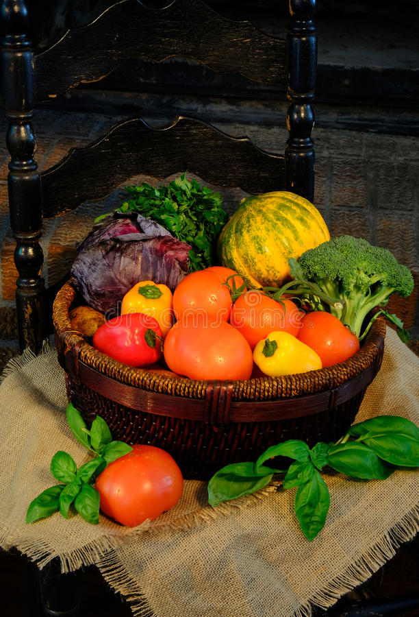 Vegetables in basket on sackcloth. Rustic style royalty free stock photo