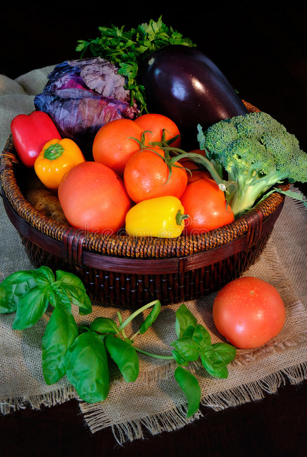 Vegetables in basket on sackcloth. Rustic style stock image