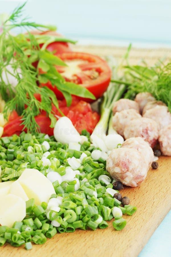 Vegetables for borscht. Chopped vegetables for borscht with pork meatballs royalty free stock images