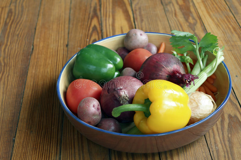 Vegetables in a bowl. Sideview narrow depth of field royalty free stock photography
