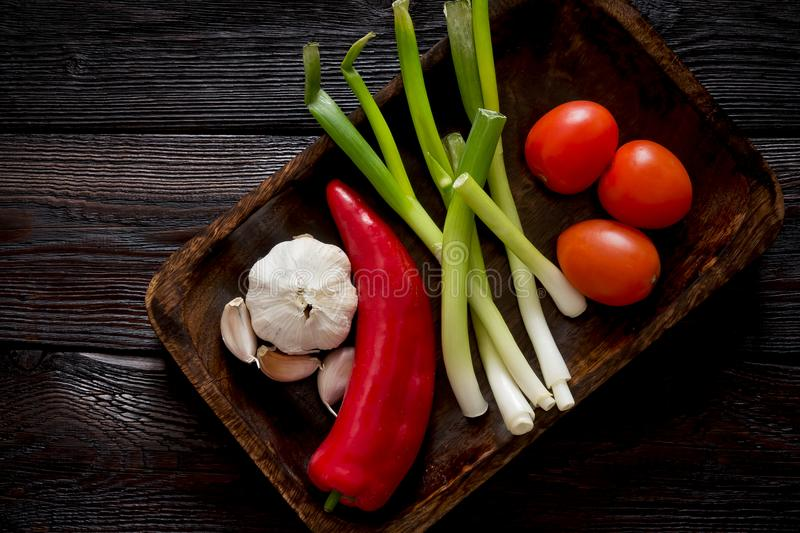 Vegetables in a bowl on old wooden table stock photos