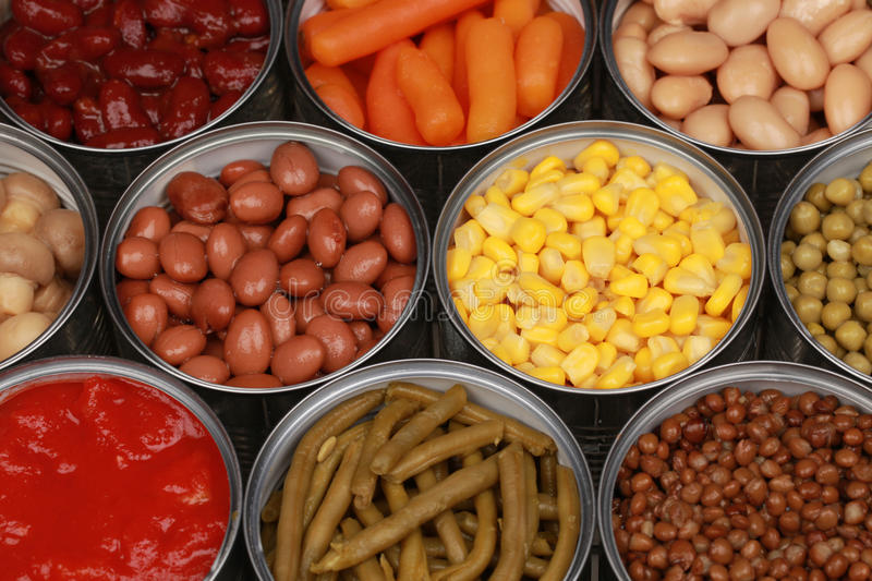 Vegetables in cans stock images