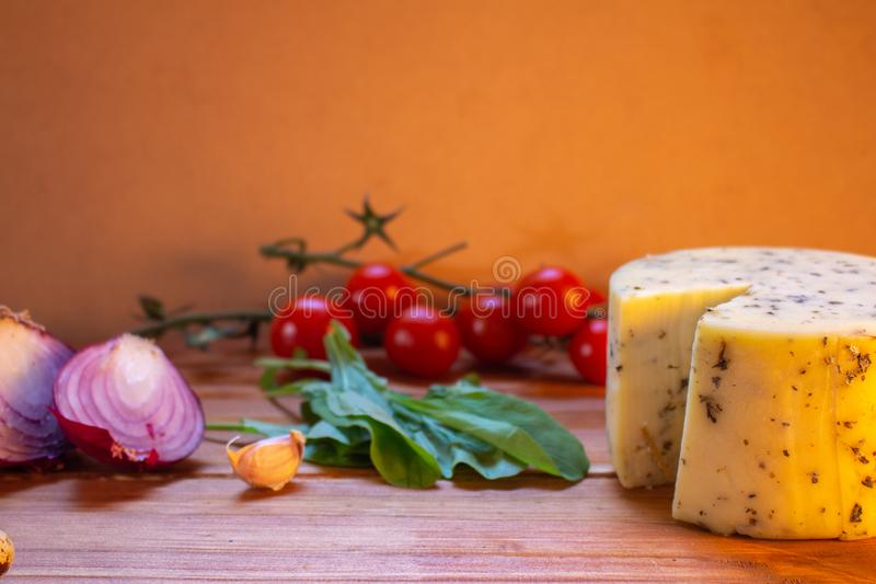 Vegetables and cheese on a rustic wooden board. Organic healthy foods Healthy food concept stock photography