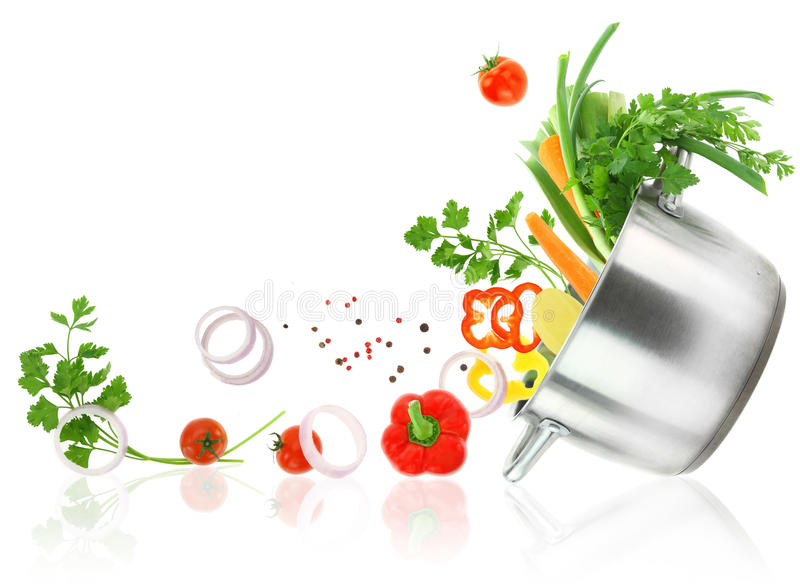 Vegetables coming out from a stainless steel casserole pot stock photography