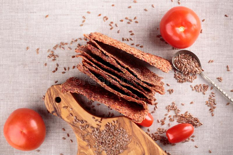 Vegetables crispbread crackers with flax seeds and tomatoes royalty free stock photography