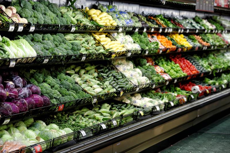 Vegetables displayed in a grocery store produce section. Salad vegetables, displayed for sale in the produce department of a modern grocery store royalty free stock image