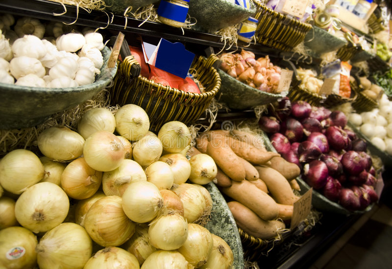 Vegetables displayed inside a grocery store stock photo