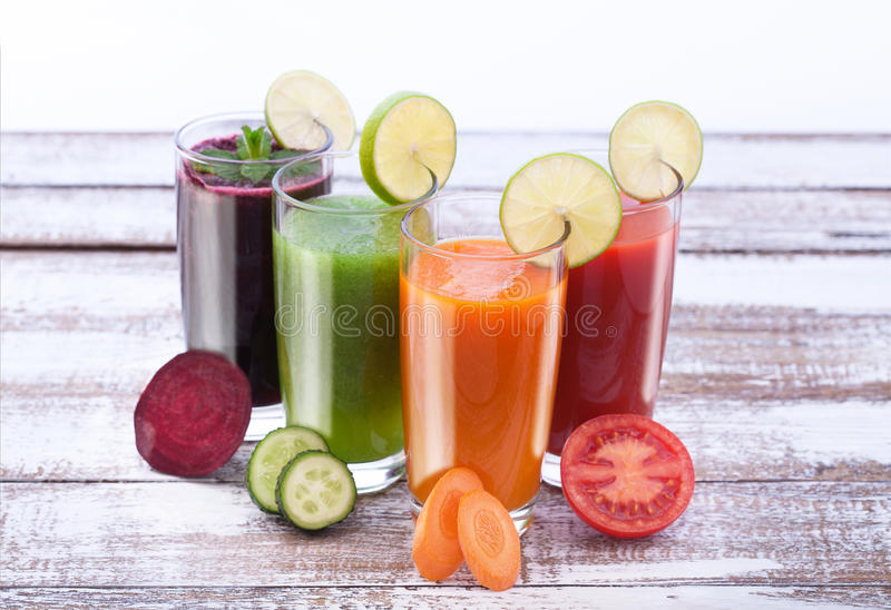 Vegetables, fresh juices mix fruit healthy drinks on wood table. royalty free stock photography
