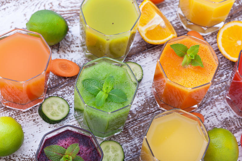 Vegetables, fresh juices mix fruit healthy drinks on wood table. stock image