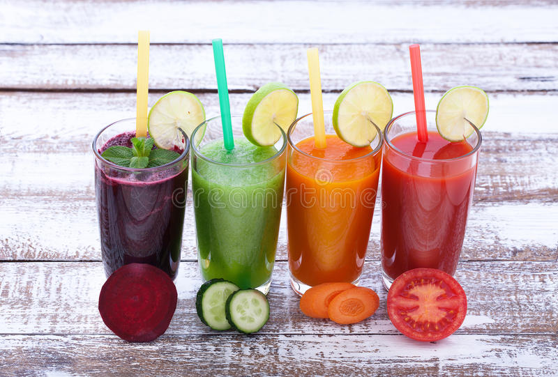 Vegetables, fresh juices mix fruit healthy drinks on wood table. royalty free stock images