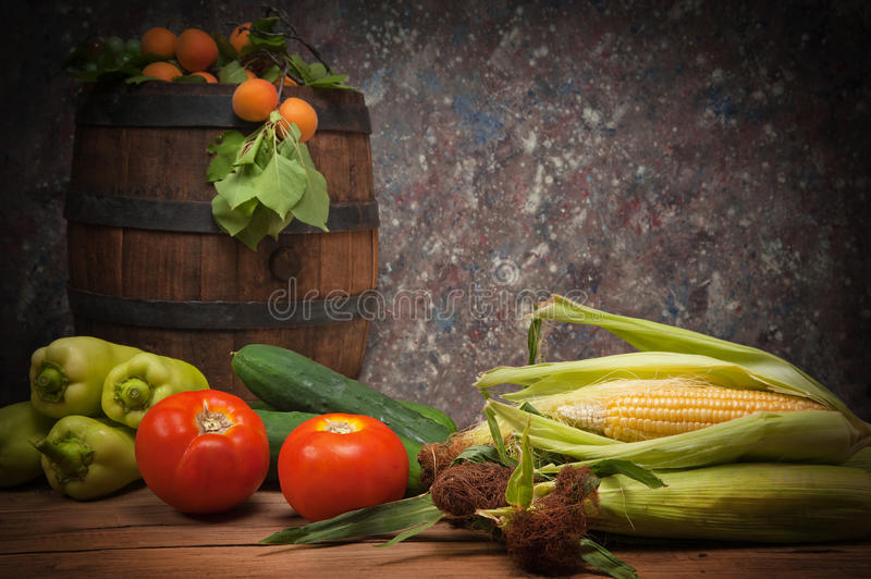 Vegetables and fruit with a wooden barrel royalty free stock photography