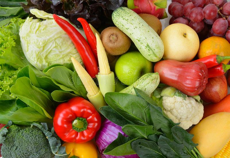 Fruits and vegetables as a background. Vegetables and fruits as a backdround stock photography