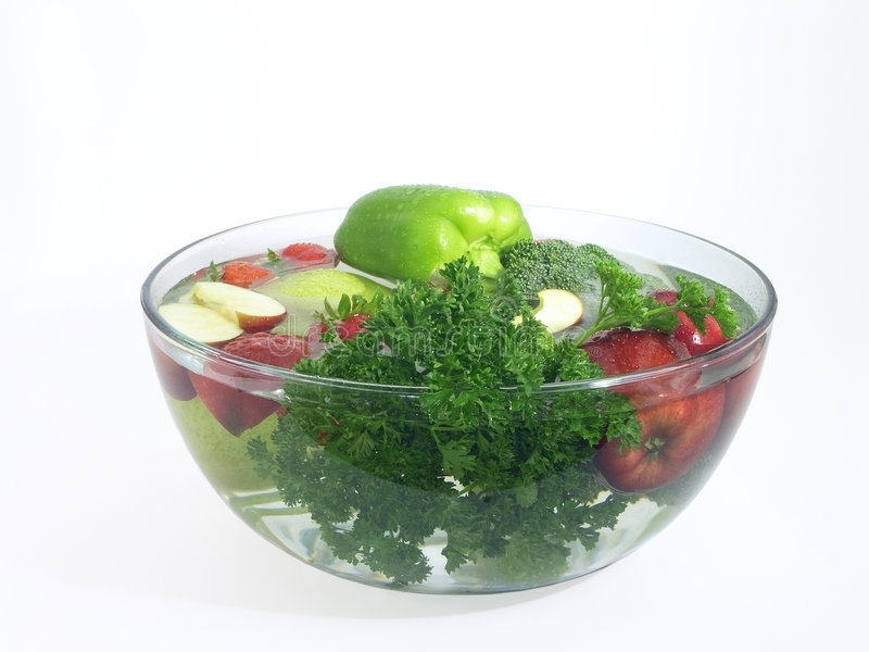 Vegetables and fruits in a clear bowl; 1 of 5. Vegetables and fruits in clear wash bowl. Click the below links to view the series: 2 of 5 3 of 5 4 of 5 5 of 5 royalty free stock photography