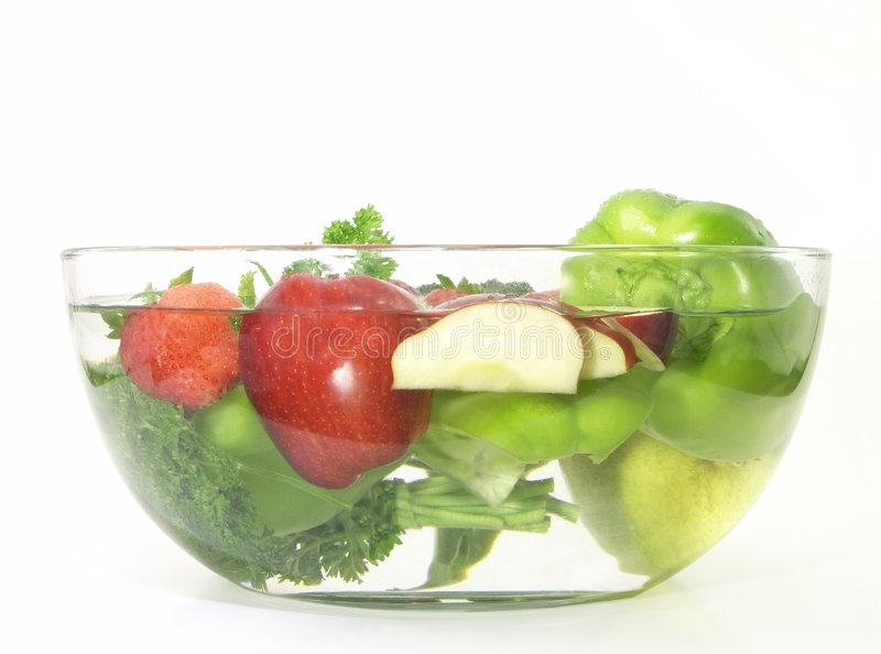 Vegetables and fruits in a clear bowl; 3 of 5. Vegetables and fruits in clear wash bowl Click the below links to view the series: 1 of 5 2 of 5 4 of 5 5 of 5 royalty free stock photography