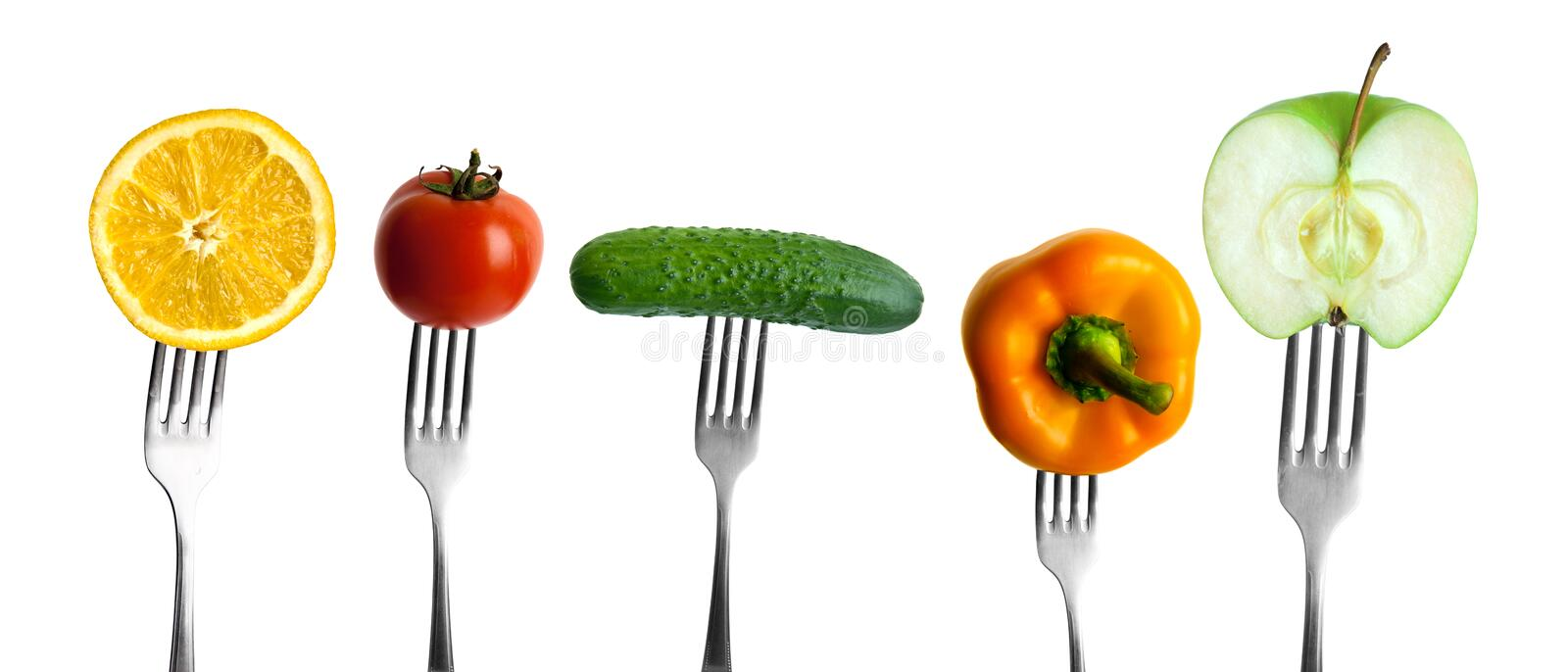 Vegetables and fruits on forks stock photography