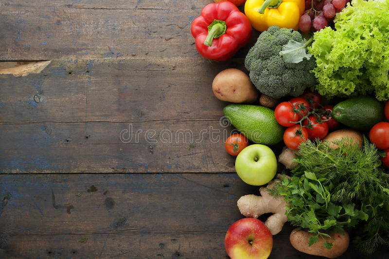 Vegetables and fruits rustic background stock photography
