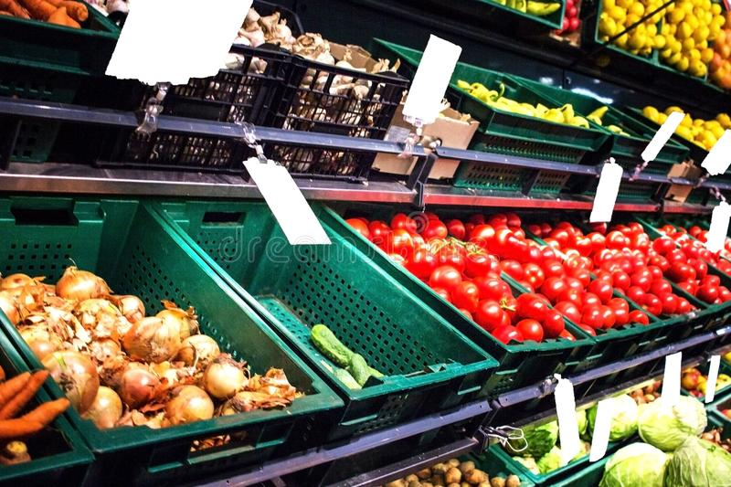Vegetables and fruits on shelves royalty free stock images