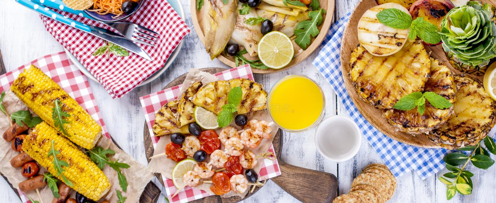 Vegetables, fruits and shrimp on the grill, for a summer lunch. Healthy food. Appetizers on a white background. Copy space. flat. Lay royalty free stock photo
