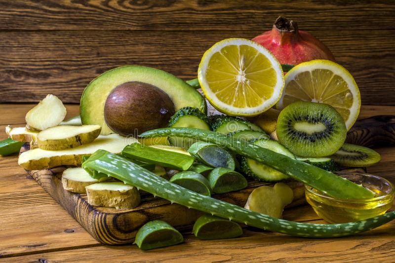 Vegetables and fruits used in alternative medicine lie on the cutting board stock photos