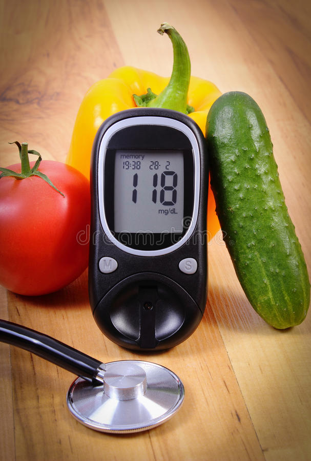 Vegetables, glucose meter and stethoscope on wooden surface, healthy lifestyle, nutrition, diabetes. Fresh ripe vegetables, glucose meter and medical stethoscope royalty free stock images