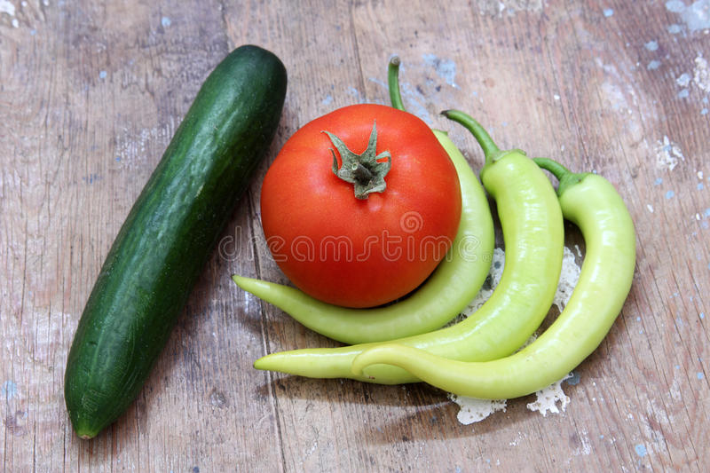 Vegetables green pepper, tomato and cucumber royalty free stock photos