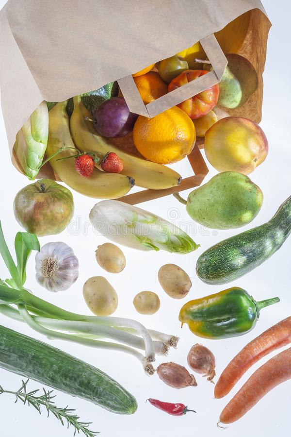 Vegetables in grocery bag isolated on a white background. stock photography