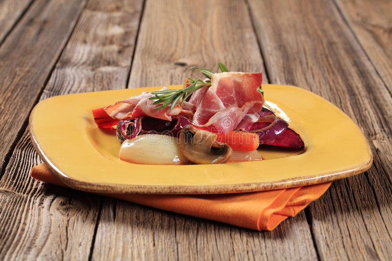 Vegetables and ham. Accompaniment -Sauteed vegetables and slices of ham royalty free stock photo