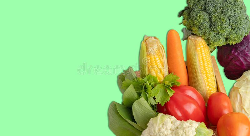 Vegetables heap on the green background royalty free stock photo