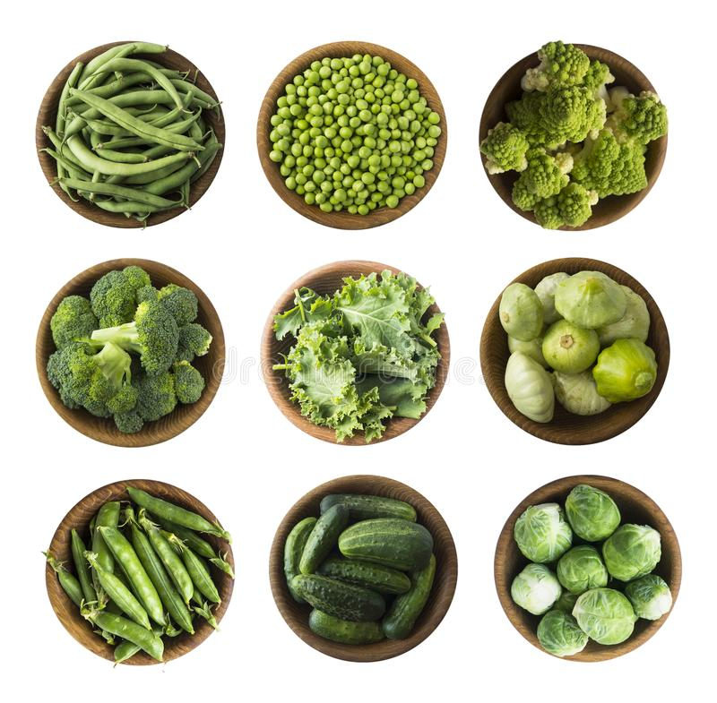 Vegetables isolated on a white. Squash, green peas, broccoli, kale leaves and green bean in wooden bowl. Vegetables with copy spac. E for text. Top view. Studio royalty free stock photos